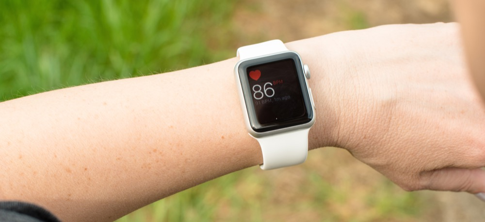 Woman checking her pulse using the Apple Watch