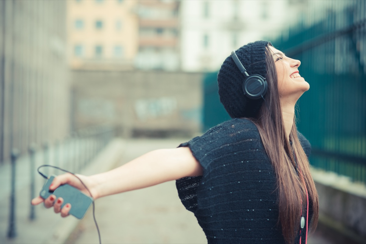 young beautiful brunette woman girl listening music headphones